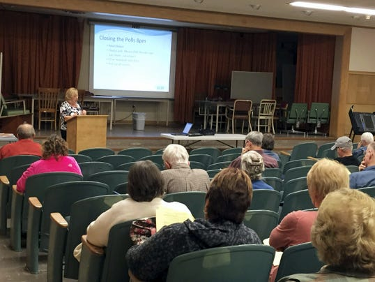 Lori Oiver, director of Lebanon County Voter Registration Office, speaks to poll workers during training held last week in the Lebanon Municipal Building auditorium for Tuesday's election.