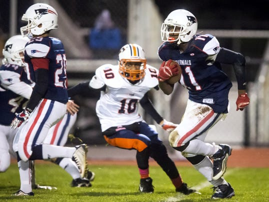 New Oxford's Ferrious Ashford (11) runs downfield against William Penn during a Friday's game at New Oxford. The Colonials used a 12-0 second half effort to beat the Bearcats, 26-14.