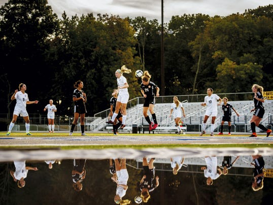 Dallastown's Mia Roxworth (9) and Northeastern's Maddie Warrender (25) leap for a header at Dallastown High School. Dallastown outshot Northeastern, 20-6, but the teams battled to a scoreless draw after two overtime periods.