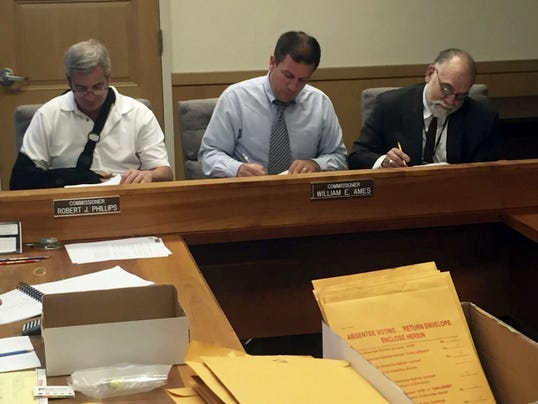 The Lebanon County Board of Elections, Judge Bradford H. Charles, county administrator Jamie Wolgemuth and President Judge John C. Tylwalk count write-in votes during Friday's computation of Tuesday's election returns.