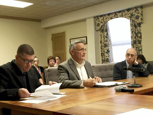Flanked by Lebanon County Christian Ministries director Troy Williams, left, and Jubilee Ministries Director Clair Weaver, David Hartman, chairman of the Lebanon County Coalition to End Homelessness, speaks to the Lebanon County commissioners last week about National Hunger & Homelessness Awareness Week events to be held Nov. 14-22.