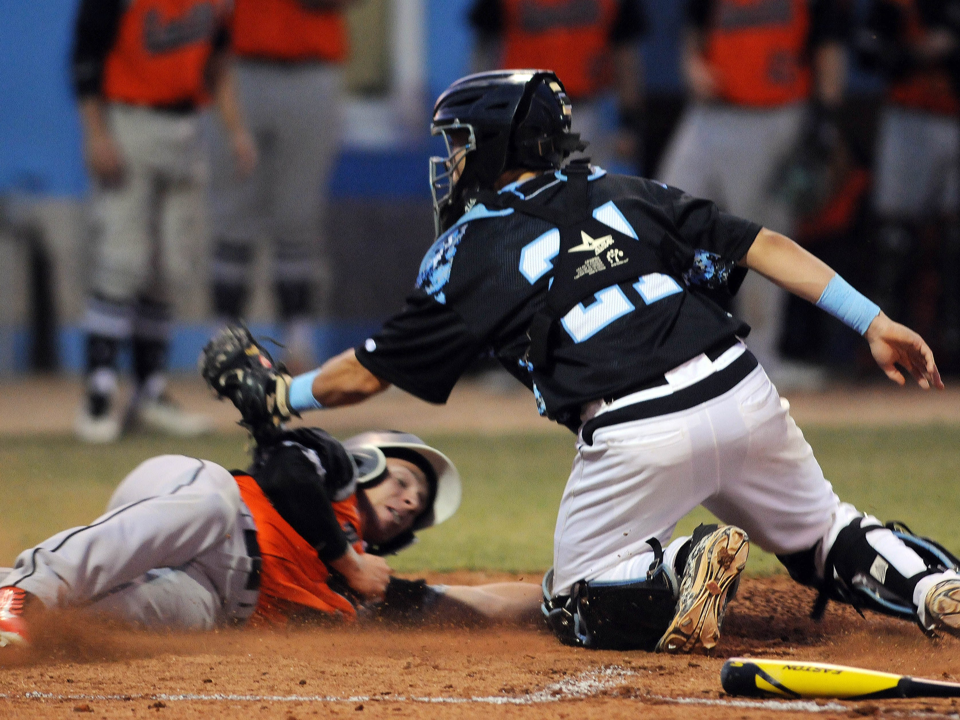 Nick Peters of Umatilla slides in under the tag of Rockledge catcher Trevor Payne (21) during Thursday's Class 5A regional quarterfinal game.