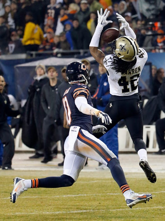 New Orleans Saints free safety Pierre Warren (42) intercepts a pass intended for Chicago Bears wide receiver Marquess Wilson (10) during the second half of an NFL football game Monday, Dec. 15, 2014, in Chicago. (AP Photo/Charles Rex Arbogast)