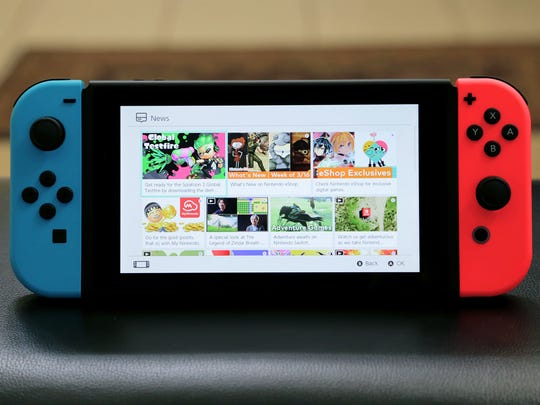 The Nintendo Switch with dual-colored neon Joy-Con controllers.