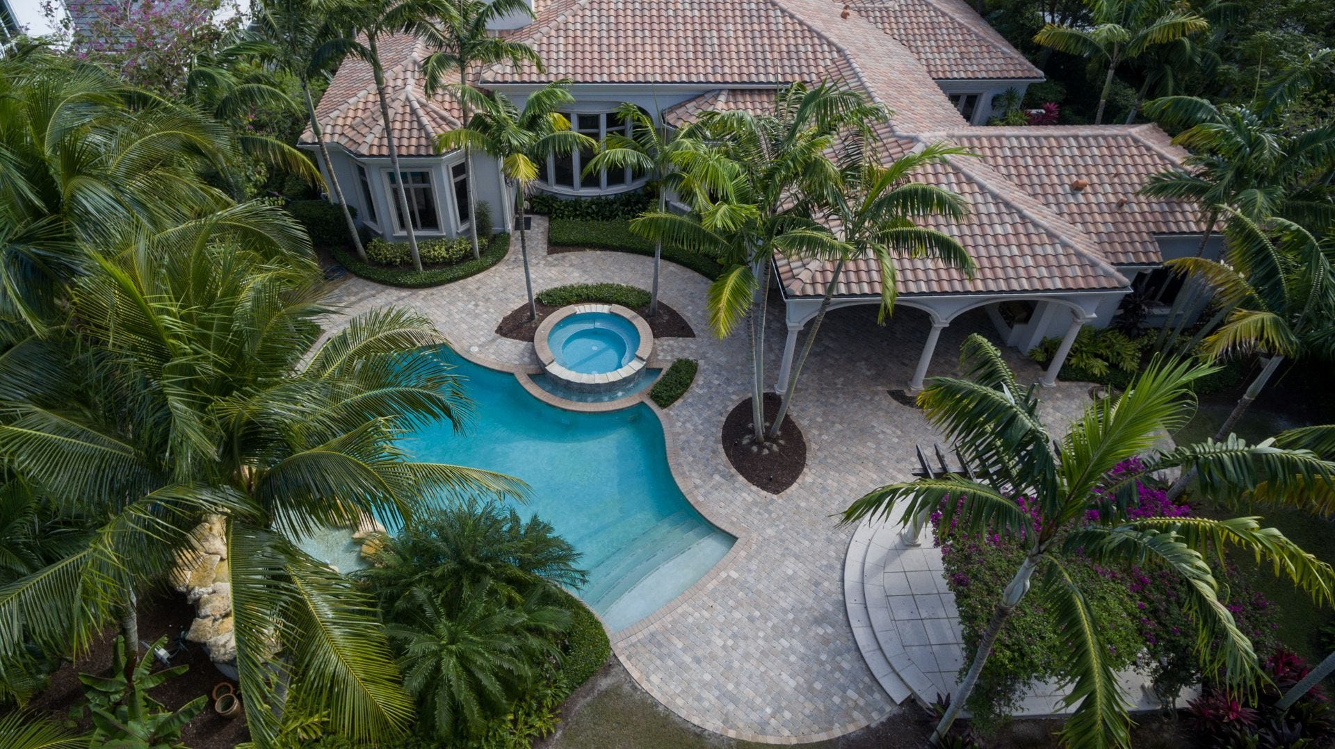 An Aerial View Shows The Lushly Landscaped Pool And