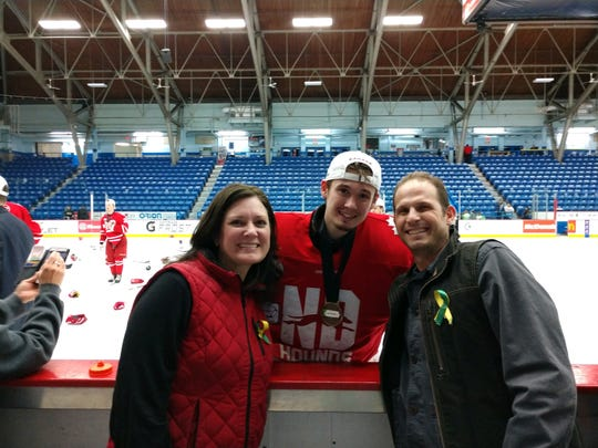 From left, Shannan, Aaron and Rick Randazzo after the Notre Dame Hounds won the Canadian AAA midget national championship. Shannan and Rick are Aaron's parents and live in Alexandria.