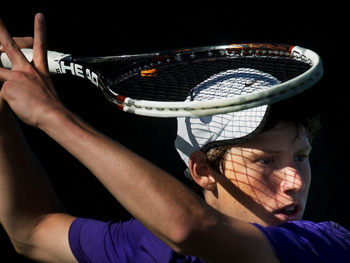 Zachary Blythe, a member of the Cypress Lake tennis team returns a ball to Bishop Verot's Erik Poland during the District 2A-12 finals at the Three Oaks tennis courts in San Carlos. Blythe won the match in an epic battle.