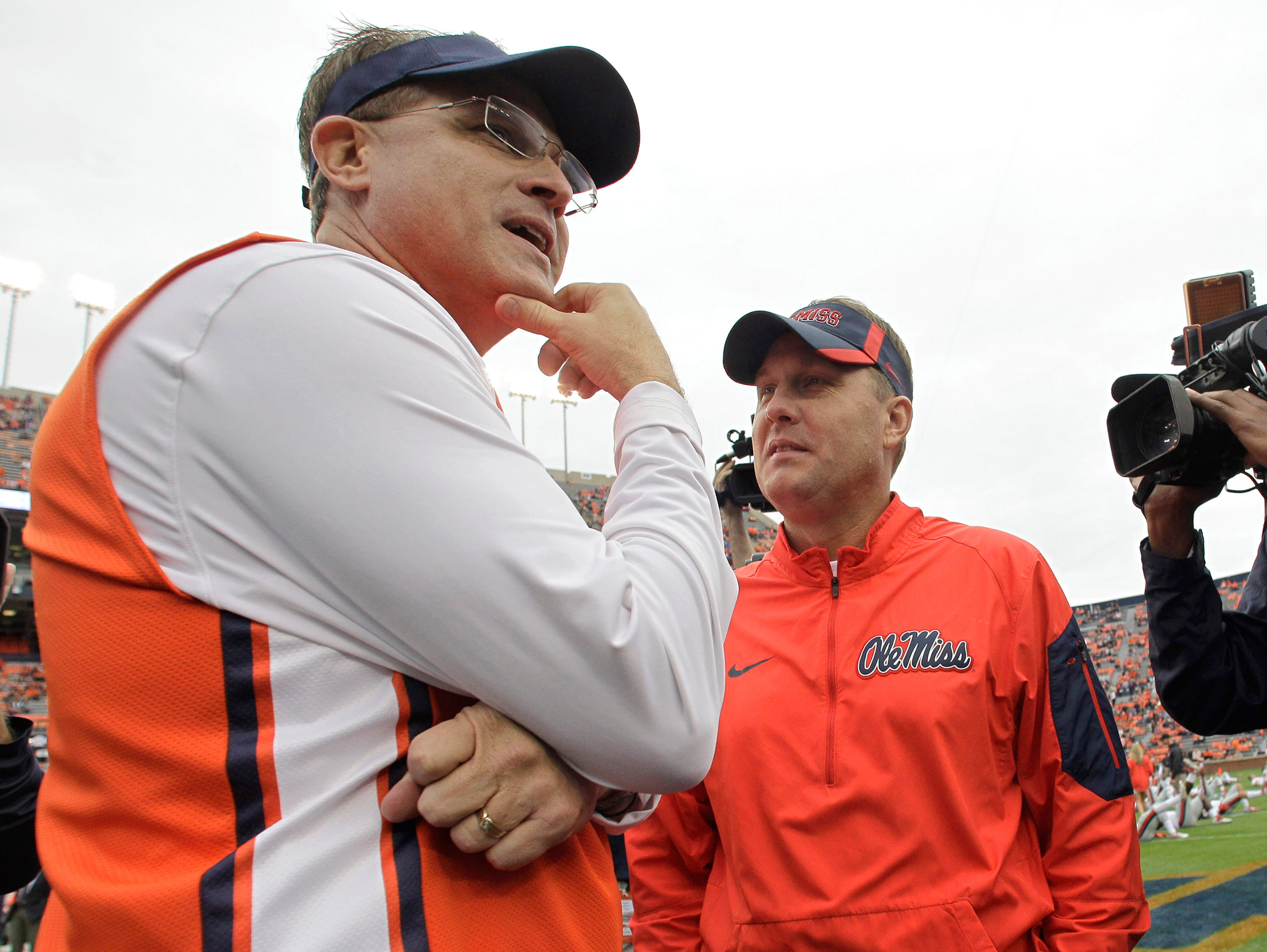 Ole Miss coach Hugh Freeze (right) wants his players to focus on Saturday's game against Mississippi State, not the Iron Bowl.