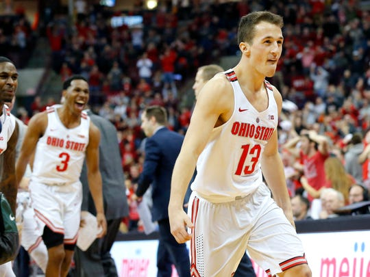 Jan 7, 2018; Columbus, OH, USA; Ohio State guard Andrew Dakich celebrates after hitting a 3-pointer at the halftime buzzer against Michigan State at Value City Arena.