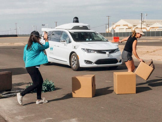 "Waymo employees place boxes as obstacles, staging ""structured"