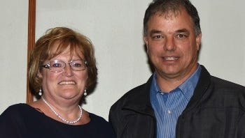 Lance Dewease was presented with the Jerry Reigle Outstanding Contribution to Sprint Car Racing Award at the EMPA convention by Reigle's mother, Mary Good.