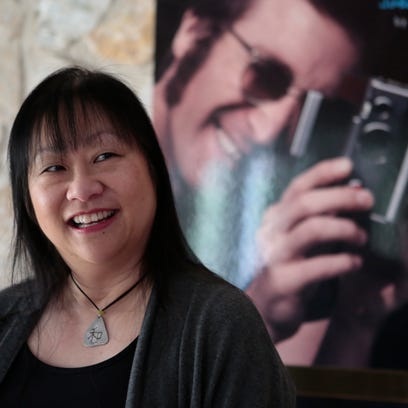 May Pang, of Pomona, is pictured here at her home.