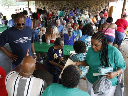 Park Day attendees gather under the Silver Springs Park pavilion after the Park Day parade in 2014.