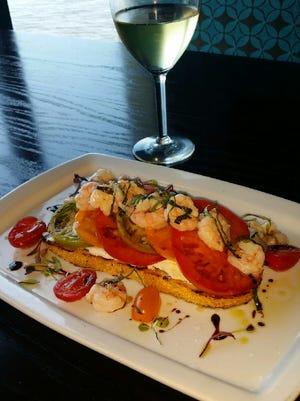Heirloom tomato, goat cheese and Florida rock shrimp bruschetta by Chef Gregg McCarthy.