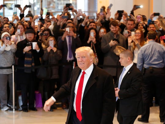 President-elect Donald Trump should reconsider his plan to raise the tax rate on carried interest, the Buckeye Institute says. Shown, Trump leaves the New York Times building following a meeting, Tuesday.