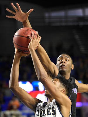 Jeremiah Barr (20) has his shot blocked by Robert Boyd (1) as Independence plays Southwind in the TSSAA  Class AAA semifinal game Friday March 17, 2017, in Nashville, TN.