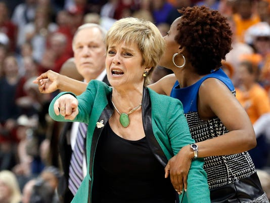 FILE - In this April 1, 2013, file photo, Baylor head coach Kim Mulkey gestures during the second half of a regional semi-final game against Louisville in the women's NCAA college basketball tournament in Oklahoma City. Baylor faces Louisville in the regional semifinals in a rematch of Louisville's stunning regional semifinal upset of the defending national champion Bears in 2013. (AP Photo/Sue Ogrocki, File)