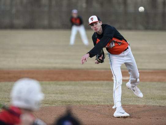 Trevor Koenig pitches for St. Cloud Tech during their