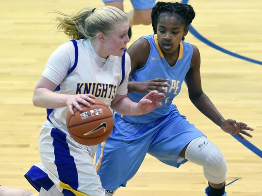 Central's Emily Truitt drives the ball down court as Cape's Lexi Watkins defends as Sussex Central and Cape Henlopen played in the first round of the DIAA Basketball Tournament in Georgetown on Tuesday.