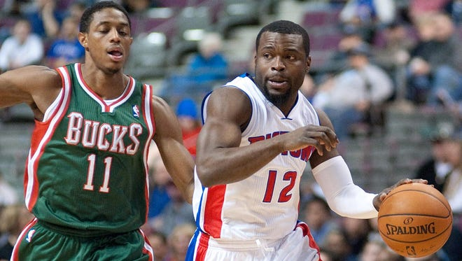 Detroit Pistons guard Will Bynum (12) dribbles the ball as Milwaukee Bucks guard Brandon Knight defends March 31, 2014.