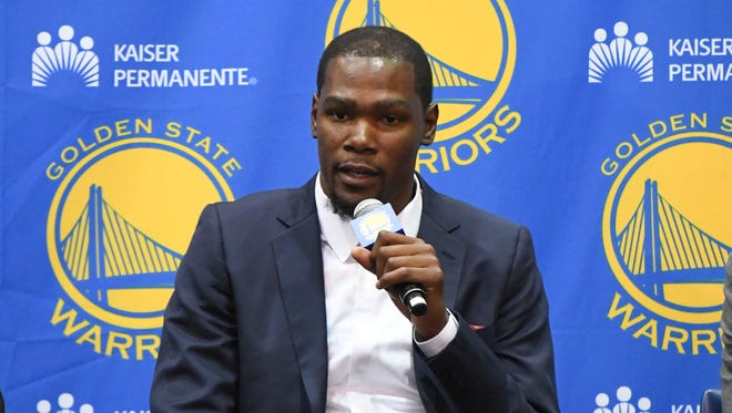 Kevin Durant addresses the media in a press conference after signing with the Golden State Warriors at the Warriors Practice Facility.