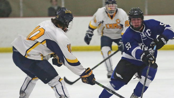 Waukesha senior Ian Malcolmson (right) will try to build upon on his junior season in which he had 37 goals and 34 assists while being named the Journal Sentinel's area player of the year.