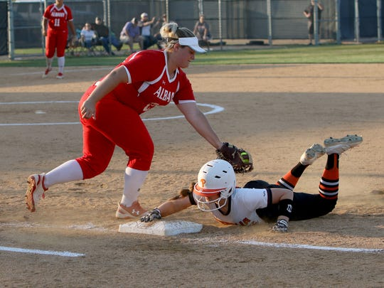 Petrolia's Kelsie Whalen slides back to first to avoid the pick-off attempt from Albany's Kaley Smith Thursday, May 24, 2018, in Graham. Albany defeated Petrolia 5-3.