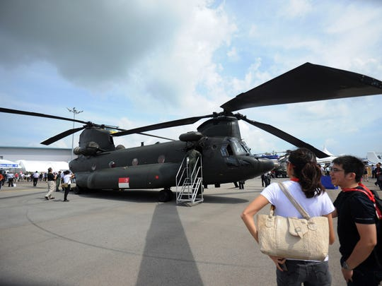 Visitors look at a Boeing CH-47 Chinook helicopter