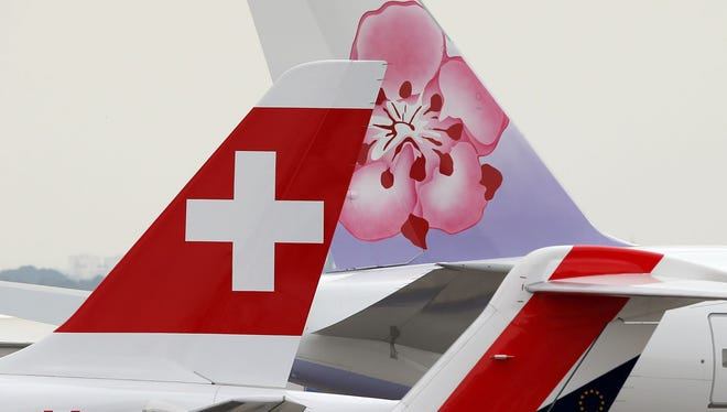 Aircraft with logos are seen at the Paris Air Show on June 15, 2015.