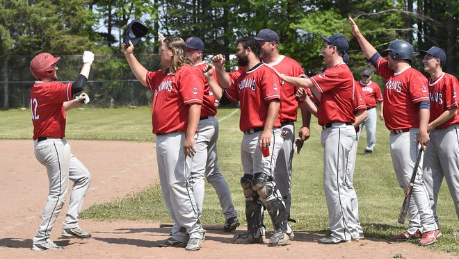 Egg Harbor's Nick Posh scores a run to tie the game at 2-2 in the fifth inning during Door County League baseball at Kolberg on Sunday. Egg Harbor rallied to win the game 8-7.