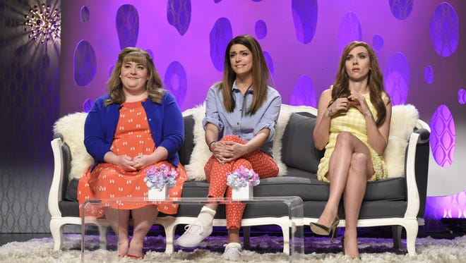 "Pictured, from left, are Aidy Bryant as Morgan, Cecily Strong as Kyra and Scarlett Johansson as Camden during the ""Girlfriends Talk Show"" skit on Saturday Night Live, May 2, 2015."