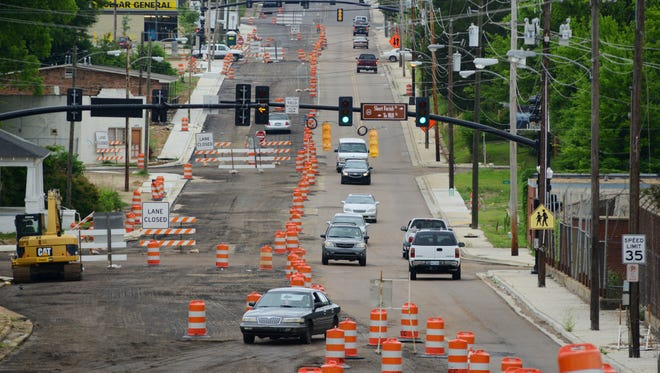 Motorists navigate a virtual obstacle course of orange safety barrels along Fortification Street between North West Street and Mill Street in Jackson on Friday.  While the Fortification renovation project is complete east of State Street, progress on the project's western end appears stalled.