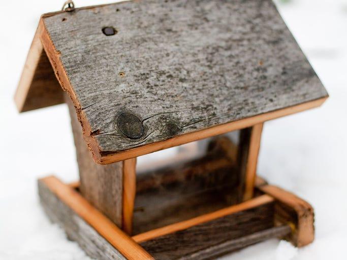 Nicholas Hardrath of Shorewood makes birdhouses using