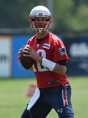 Jun 13, 2017: New England Patriots quarterback Tom Brady (12)  sets to throw a pass during minicamp at Gillette Stadium practice field.