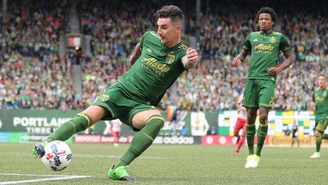 Portland Timbers defender Liam Ridgewell (24) kicks the ball away from Atlanta United in the second half at Providence Park.