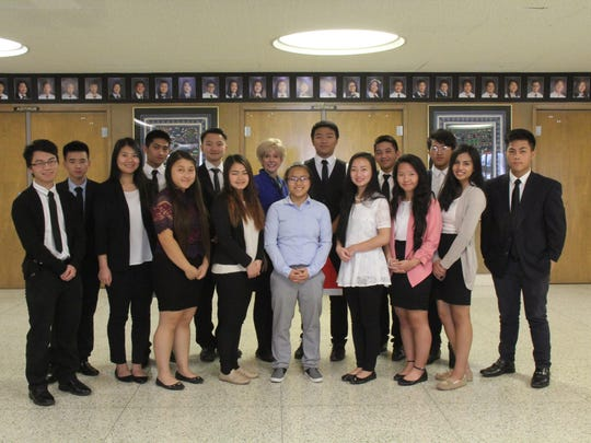Vicki Kalman (back row center) is pictured with students at the Hmong American Peace Academy, where she worked until shortly before her death.