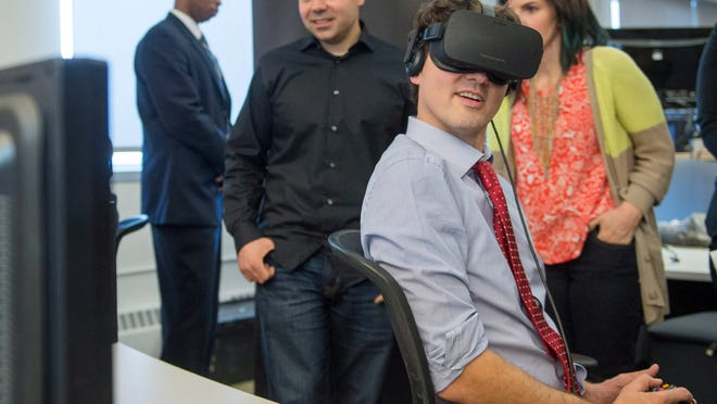 Prime Minister Justin Trudeau plays a virtual reality video game during a visit to video game maker Ubisoft, Thursday, Feb.  25, 2016 in Montreal. (Ryan Remiorz/The Canadian Press via AP) MANDATORY CREDIT