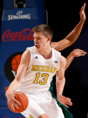 Michigan forward Moritz Wagner (13) looks to score in the first half of the 102-47 win over Charlotte Thursday in Paradise Islands, Bahamas.