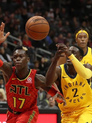 Indiana Pacers guard Darren Collison (2) looses control of the ball against Atlanta Hawks guard Dennis Schroder (17) during the first quarter at Philips Arena.