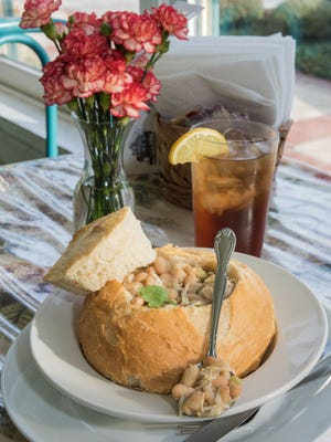 White bean chicken chili served in a bread bowl and garnished with cilantro at Cottage Cafe at 11609 Main St. in Middletown, Ky. Feb. 5, 2016