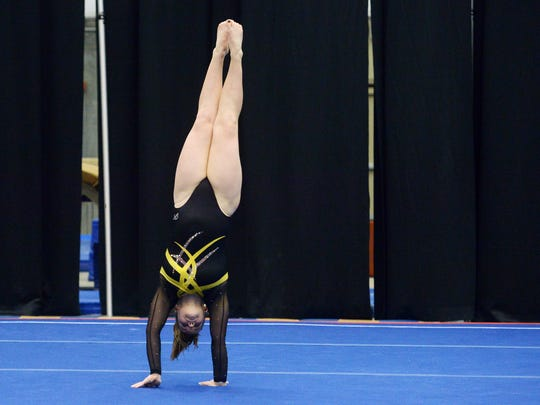 Emily Prill of Mitchell competes on the floor routine