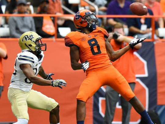 Syracuse Orange wide receiver Steve Ishmael catches a pass in front of Pittsburgh Panthers defensive back Phillipie Motley during the fourth quarter at the Carrier Dome.