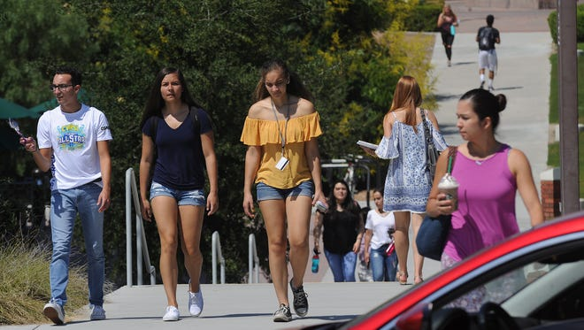 Students walk the campus at California Lutheran University in Thousand Oaks on , the first day of classes this year.