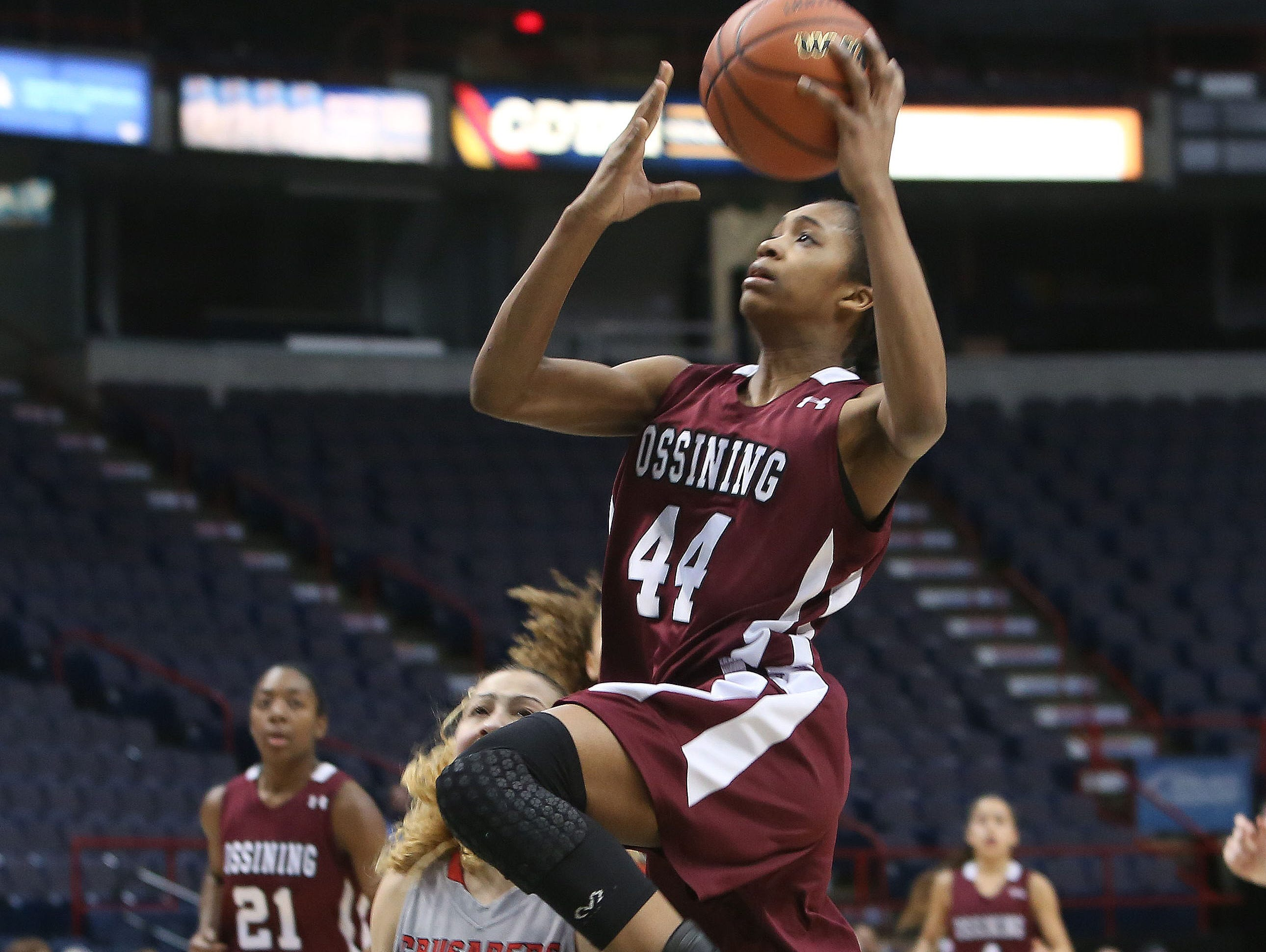 Ossining's Aubrey Griffin (44) goes up for a shot in front of Long Island Lutheran's Grace Stone (10) during the girls Class A final of the New York State Federation Tournament of Champions at the Times Union Center in Albany March 18, 2016.