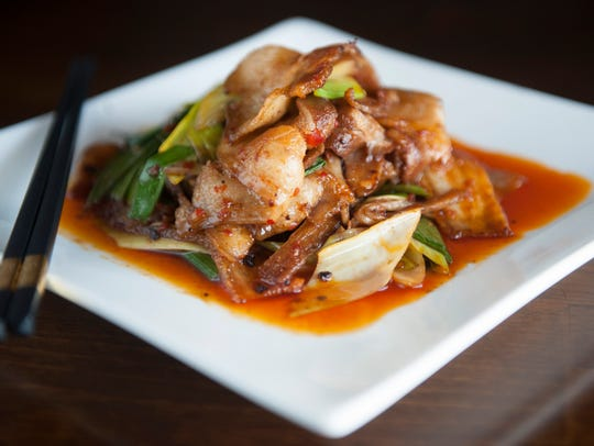 Twice Cooked Pork Belly is prepared with Hoisen, stir fried leek and green peppers.