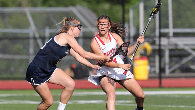North Rockland's Aleya Corretjer  (15) works the ball to the goal during the girls lacrosse class A regional semifinal  against Saratoga at Fox Lane High School in Bedford on Wednesday.