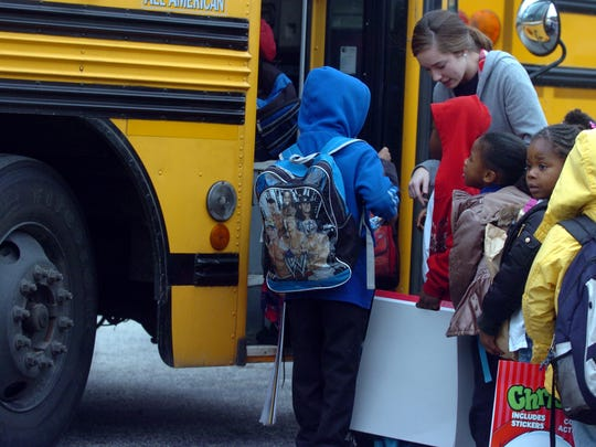 Lincoln Elementary School first grade teacher Blair Beckham helps students onto a school bus during dismissal on the last day of classes before winter break in this Sun file photo. Jackson-Madison County School buses are on a two-hour delay due to extreme cold weather for Thursday, their first day back to class.