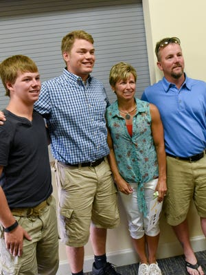 Matt Shaver, 18, poses with Deb Janssen, one of the first responders during Matt's emergency on June 29th, and her family on Monday, August 3, 2015, during the celebration to honor Johnston life savers held at Johnston City Hall.