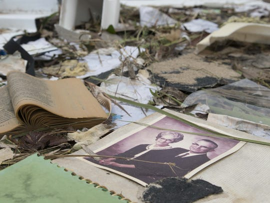 A soggy family photograph lay in the rubble of a Port