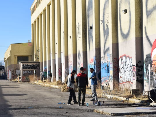 "A submitted photo showing a group of people standing next to a seemingly abandoned warehouse on Dermody Way in Sparks. The buildings on the property were used as a ""graffiti park,"" where several people visited to tag walls."